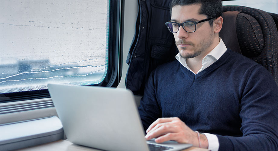 man+laptop in train